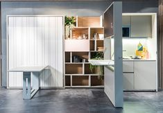 """The Italian company Clei makes some amazing space-saving products like this hide-away kitchen """"Kitchen Box,"""" that the company just presented at The Salone del Mobile. It is composed of two equipped elements, one contains the pantry and a tilting table that, once open, join the top creating a wide service surface. The other element contains …"""