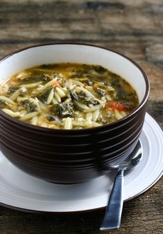 Spinach Tomato Orzo Soup  Ingredients  1 large onion, chopped  2 cloves garlic, chopped  1 lb spinach  1 – 15 oz can diced Italian tomatoes (with oregano and basil)  1 lb package orzo pasta  2 quarts canned chicken or vegetable stock  2 quarts water  olive oil