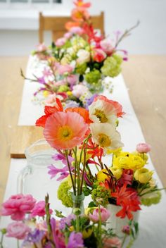 This wedding table filled with vibrant poppies is a wonderful display for your special day.