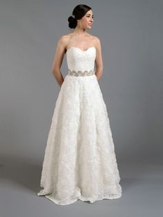 Ivory strapless lace wedding dress with rosette skirt