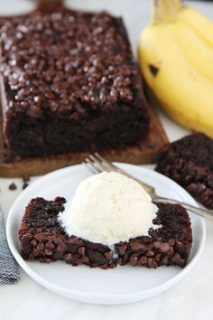 Gluten-Free Vegan Chocolate Banana Bread Recipe on twopeasandtheirpod.com You will never know this chocolate banana bread is gluten-free and vegan. It is SO good! Top it with ice cream and you have an amazing dessert!