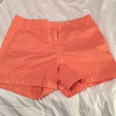 J. Crew chino short A gorgeous sherbet/orange color with no signs of wear or stains. Perfect for summer!! J. Crew Shorts