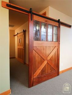 interior wooden barn door with windows- love these doors