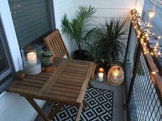 Apartment small balcony decor ideas and design. Balcony garden with candles, string lights, and tropical plants. Perfect for hot summer nights.
