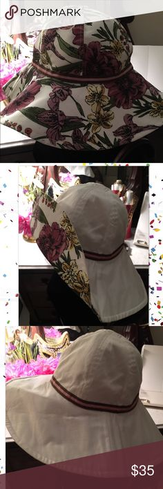 """Laundry reversible beach hat! Fabulous colors! Laundry by Shelli Segal reversible beach hat. One side is gorgeous deep shades of plums-blush-yellow & green flowers 🌺 w/a thin blush & brown grosgrain ribbon. Reverse is white w/same type of ribbon. 🎀 This hat matches the clear bag w/identical flowers & white trim also sold in my closet. Buy the bag & take $5 off this listing. Colorful, chic & fabulously fun to wear to the beach or """"pop"""" any spring/summer outfit‼️ 🏝 EUC  Worn once. One size…"""