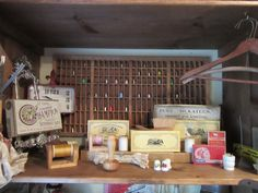Vintage coats and clark thread boxes and collection of thimbles