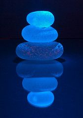 these are pieces of sea glass, looks like lit from behind. cool concept - light through a collection of glass beads in a jar