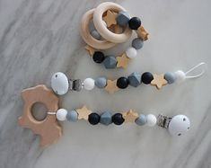 Pacifier clip, rattle and toy