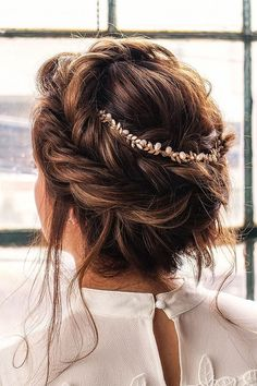 Crown braid with messy updo hairstyle idea #hairstyle #crownbraid #braids #updo #upstyle #weddinghair #hairstyleideas