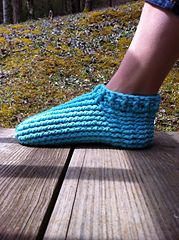 """This is a PDF crochet pattern for the most comfy pair of adult winter slippers ever! One of my pattern testers dubbed them """"squishy foot massagers"""", lol. The pattern uses front and back post double crochet for a super thick texture that not only is very comfortable, but super warm! The pattern is written for bulky or chunky yarn (5 weight) but 2 strands of worsted weight yarn held together can be substituted as well. Using 2 strands held together is a GREAT way to make a pair of slippers…"""