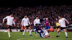 Aymen Abdennour of Valencia CF tackles Lionel Messi of FC Barcelona during the La Liga match between FC Barcelona and Valencia CF at Camp Nou stadium on March 19, 2017 in Barcelona, Catalonia.