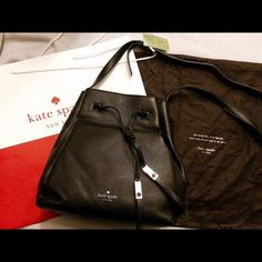 """10/4 HPNWT Kate Spade Medium Cooper Trendy & Chic pebble black leather bucket bag from Kate Spade! Model/style is  Cooper. Bag has gold hardware and comes brand new, wrapped in store packaging. Perfect leather bag for Fall, measures approx. 13"""" x 11"""" x 6"""" with an adjustable strap for shoulder or crossbody wear. Bag has a drawstring Closure, black logo interior, interior zip pocket and 2 slip pockets. Comes with dustbag! Will consider lower price w/o dust bag ⛔️No trades please!⛔️ kate spade…"""
