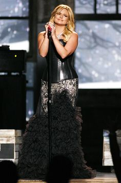 "Miranda Lambert Lambert, who picked up both Album of the Year and Female Vocalist of the Year, paired a licorice leather corset by Ani + Ari and a feathered skirt with lace paneling by Andru Chrisst for her moving performance of ""Over You."" She accessorized with Steve Madden boots and a bevy a jewels from Karen Linder, Loree Rodkin and Borgioni."