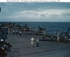 Grumman F6F Hellcat fighters warming up on the flight deck, while USS Cowpens (CVL-25) was operating with Task Group 58.3 during raids on the Marshall Islands, circa January 1944.