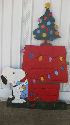 Here's Snoopy getting ready for Christmas decorating his dog house. He's even got his adorable Christmas Tree on top ready to go! Snoopy is ready to go with durable paint and protective coating to end Snoopy Christmas Decorations, Christmas Yard Art, Office Christmas, Xmas Decorations, Christmas Projects, Christmas Holidays, Christmas Crafts, Christmas Ideas, Christmas Lights