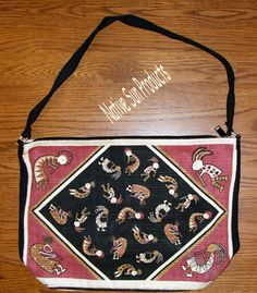 "A roomy 13x19"" flat bottomed canvas purse that has dozens of flute playing kokopelli printed on both sides. Zips close w. an over the shoulder carry strap. New $21.95 w/ free shipping #purse #kokopelli #nativeamerican #handbag"