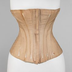 Corset from the Worcester Skirt Company, 1861-1863, at The Met.  Very plain in construction and embellishment, but the shape is appropriate.