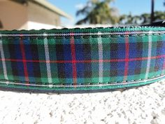 Scottish tartan 1 width Modern MacKenzie in either Side Release buckle collar OR Martingale collar style. Imported Scottish Tartan ribbon in Hunter Green, Navy, Royal Blue, Red & White sewn on Hunter Green or your color choice of soft heavy duty nylon webbing. Heavy duty custom welded nickel hardware including the slide that adjusts for a sleek look. Collar is box stitched at stress points. Contoured heavy duty nylon (not plastic except slim line style) USA made side snap buckle on SIDE R...