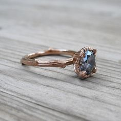 Profile of Dark Grey Moissanite Twig Engagement Ring with carved floral setting in recycled 14k rose gold.