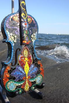 mosaic violin. Reminds me of Barcelona because their mosiac art has almost that exact design, but a bit brighter.