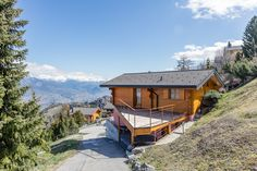 """Chalet """"La Montau"""" located near the ski slopes. Currently on the market. Contact us for further info : info Swiss Chalet, Jacuzzi Outdoor, Wooden Terrace, Ski Slopes, Ski Lift, Stunning View, Alps, Nice View, Switzerland"""