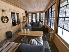 Dressed with weatherproof wicker and accessorized with linen Robert Allen toss pillows, this Canadian log home's sunroom is a comfy and inviting place to chill year-round. Patio Design, House Design, Plan Chalet, Sunroom Decorating, Decorating Ideas, Decor Ideas, Log Cabin Decorating, Cabin Pressure, Cabin Porches