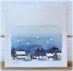 handmade winter card from Rapport från ett skrivbord ... clean and simple one-layer ... stamped  band of winter buildings at bottom of watercolor paper front ... ombré wash of deep blue fading into the top ... sprinking of tiny white punched stars ... delightful!