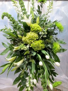A funeral composition of natural whites and green tones designed elevated on an easel. This design can be ordered alone or in conjunction with the Belfast Casket Spray. Casket Flowers, Grave Flowers, Cemetery Flowers, Funeral Flowers, Church Flowers, Wedding Flowers, Funeral Floral Arrangements, Beautiful Flower Arrangements, Beautiful Flowers