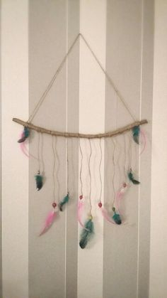 DIY wall hanging with feathers