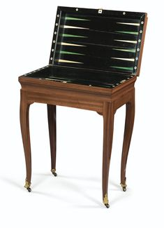 A GILTBRONZE MOUNTED MAHOGANY, EBONY AND IVORY TRIC-TRAC TABLE, LATE LOUIS XV, IN THE MANNER OF JEAN-FRANÇOIS OEBEN, PARIS, CIRCA 1760