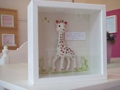sophie the giraffe.such a cute display/keepsake. might try to modify this with one of jack's first favorite toys. Giraffe Party, Giraffe Birthday, White Shadow Box, Baby Memories, Barn Quilts, Keepsake Boxes, Girl Room, Decorative Accessories, First Birthdays