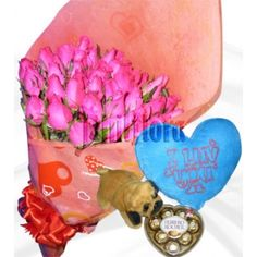 Send this five dozen cerise roses in a bouquet to your mom on Christmas Day with blue heart shaped pillow, stuff dog and ferrero rocher heart. Make your feelings known loud and clear with a fresh bouquet of exquisite pink roses, an unforgettable gift of sophisticated beauty. Online Flower Shop, Ferrero Rocher, First Anniversary, Perfect Match, Chocolates, Pink Roses, Heart Shapes, Bouquet, Bear