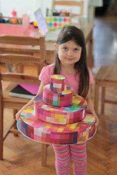 """Cupcake Stand made from styrofoam cake bases and decorative papers... great idea!  If you add a clear layer of contact paper (or laminate the paper) it would provide a """"wipeable"""" surface for continued usage."""