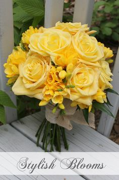 Yellow bouquet wrapped in white birch bark and accented with organic ribbon bow