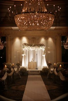 "Brides.com: A Glamorous Summer Wedding in New York City. Mallorie and Daniel's ceremony took place inside an Essex House New York ballroom lit by ornate crystal chandeliers and soft candlelight. ""We wanted the ceremony to feel light and ethereal, with blush flowers, no greens and a billowy chuppah,"" Mallorie says of the ceremony décor."