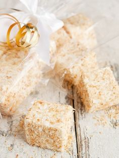 Delicious and easy homemade marshmallows recipe, rolled in toasted coconut. Perfect for holiday gifts or for party or wedding favours.