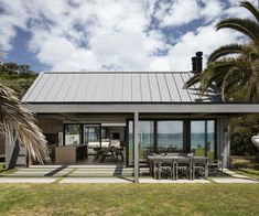 How this waterfront Waiheke bach enjoys both privacy and views One Storey House, Cedar Cladding, New Zealand Houses, Waiheke Island, Timber Door, Storey Homes, The Gables, Big Windows, Stone Flooring
