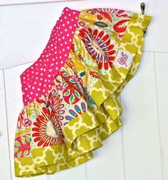 This EXTRA full twirl skirt is perfect for the spring! This skirt features fabric from Dena Designs new collection KUMARI GARDEN. Our skirts feature a drop waist, bottom band with a woven Bella Grace Creations tag, and has over 80 inches of fabric gathered into them to make them EXTRA twirly.   ...