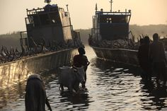 Photographer: Andreea Campeanu, 2014 A man displaced by the fighting in Bor County, South Sudan arrives in the port in Minkaman in Awerial County, Lakes State in South Sudan. This photo was taken on January 15, 2014.