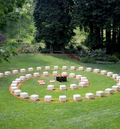 """Winding Road   One option is a ceremony in the round, in which the guests surround the couple on all sides. Another even more inventive layout is a spiral formation. Says San Francisco planner JoAnn Gregoli of Events of Distinction, who designed the wedding shown here, """"Make a statement that keeps guests on the edge of their seats! The standard rows and center aisle are predictable, so surprise them with an innovative experience like a spiral aisle of ottomans."""
