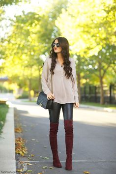 Nude blouse, leather pants, Chanel bag and burgundy suede over-the-knee boots for fall outfit.