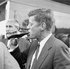 JFK enjoying a coke. This reminds me of Forrest Gump when he was drinking all the doctor peppers