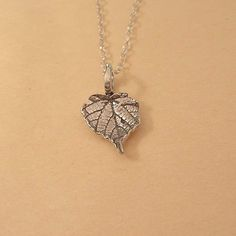 tiny charm necklace wild grape leaf solid by stratussilver on Etsy