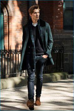 Jeff Ryan embraces classic menswear with Club Monaco's funnel-neck topcoat, merino v-neck sweater, slim mini foulard shirt, and super slim denim jeans with Allen Edmonds Dundee boots.