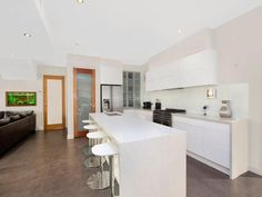 White kitchen with large coloured floor tiles Galley Kitchen Design, New Kitchen, Kitchen Ideas, Kitchen Images, Kitchen Photos, Granite Kitchen, Beautiful Kitchens, Tile Floor, Tiles