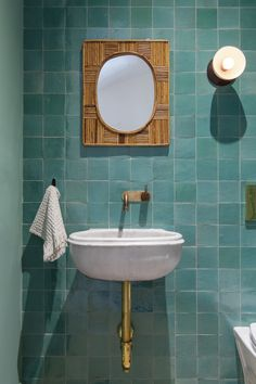 bathroom Architect Elizabeth Roberts Brooklyn townhouse remodel with three-story addition Turquoise-tiled powder room in a Brooklyn townhouse remodel by Elizabeth Roberts Architecture and Design. Photograph by Dustin Aksland. Tile Trends, Bathroom Mirror, Round Mirror Bathroom, Rustic Bathroom, Half Bathroom Remodel, Bathrooms Remodel, Bathroom Design, Tile Bathroom, Bathroom Wall