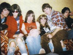 The Ramones, P.J. Soles (Riff Randall), and co-screenwriter Richard Whitley relax between takes on the Vince Lombardi High set during the shooting of Rock & Roll High School