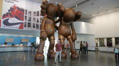 We went to the Brooklyn Museum to see KAWS's 18-foot wood sculpture and capture a day in its life.
