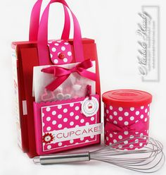 super cute cupcake gift set for under 12$ - including icing, sprinkles, cake mix and cardstock & ribbon to wrap... inspiration for an upcycled version using a cereal or cracker box & fabric scrap instead of ribbon... definitely have to make this one