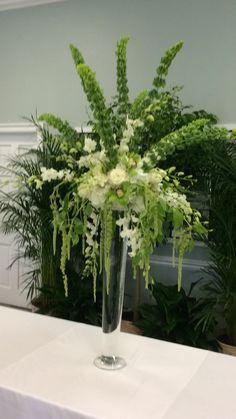 Buffet centerpiece green and white.  Atdweddingandeventflowers.com